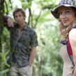 Man and woman in a forest expedition. — Stock Photo