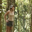 Young woman looking ahead in a tropical forest. — Stock Photo