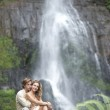 Couple hugging by waterfalls. — Stock Photo #21103527