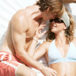 Young couple relaxing and being affectionate on a sunbed while on vacation. — Stock Photo #21103867