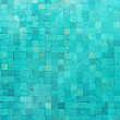 Over head view of a blue swimming pool with mosaic tiles and still water. — Stock Photo