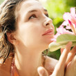 Young attractive girl smelling a rosebay flower — Stock Photo