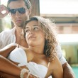Sexy young couple lounging on exterior tropical bed — Stock Photo #21105249