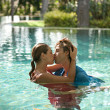 Sexy young couple submerged in a swimming pool while dressed — Stock Photo #21105903
