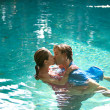 Sexy young couple submerged in a swimming pool while dressed — Stok fotoğraf