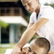 Young man enjoying a massage in a spa, outdoors. — Stock Photo #21105957