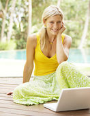Attractive woman using a laptop computer — Stock Photo