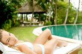 Young woman wearing a bikini and lounging — Stock Photo