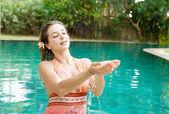Woman in a swimming pool — Stock Photo
