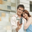 Young couple arriving at their new home — Stock Photo #21183235