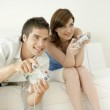 Man and woman playing video games at home. — Stock Photo