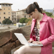 Young woman using a laptop outdoors — Foto de Stock