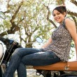 Attractive young woman sitting on her new motorbike — Stock Photo