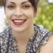 Portrait of a young woman smiling and wearing red lipstick — ストック写真