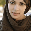 Muslim woman wearing a head scarf and looking at camera. — Stock Photo #21738009