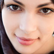 Muslim young woman wearing a head scarf and smiling at the camera — Stock Photo #21738011