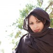 Muslim young woman wearing a brown head scarf — Stock Photo #21738049