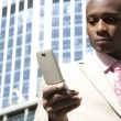 Businessman using a cell phone in the financial district. — Stock Photo #21738457