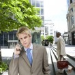 Two businessmen outside an office building, — Stock Photo