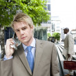 Two businessmen outside an office building — Stock Photo