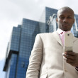 Detail of a mobile phone being used by a businessman in the financial district. — Stock Photo #21738877