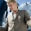 Young businessman celebrating in the city — Stock Photo