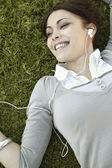 Young woman listening to music on her headphones — Stock Photo