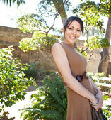 Woman visiting a touristic sight's garden — Stock Photo