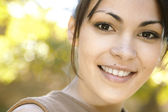 Young woman's smiling face — Stock Photo