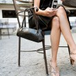 Low section of a sexy businesswoman sitting in a luxurious coffee shop terrace - Foto Stock