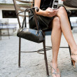 Low section of a sexy businesswoman sitting in a luxurious coffee shop terrace - Zdjęcie stockowe