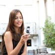 Portrait of a beautiful businesswoman using a cell phone - Stock Photo