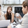 Three business having a meeting at a coffee shop's terrace — Stock Photo