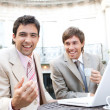 Two businessmen laughing while having a meeting  — Photo