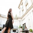 Elegant businesswoman walking to a meeting in a luxury building coffee shop terrace — ストック写真