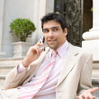 Elegant businessman having a conversation on a cell phone — Stok fotoğraf