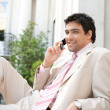 Elegant businessman having a conversation on a cell phone — Foto de Stock