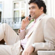 Stock Photo: Elegant businessman having a conversation on a cell phone