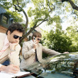 Stock Photo: Two attractive businessmen meeting in tree lined street