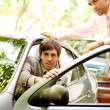 Two attractive businessmen with a smart car — ストック写真