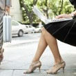 Businessman walking passed a sexy businesswoman - Stock Photo