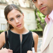 Attractive businessman and businesswoman meeting in a classic city street — Stok fotoğraf