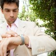 Young attractive businessmlooking at time in his watch — Stock Photo #21929253