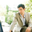 Attractive young businessman using a laptop computer — Stock Photo #21929903
