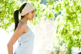 Profile view of an Idian girl standing by a lake on a sunny golden day. — Stock Photo