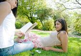 Two Indian girls spending time in the park — Stock Photo