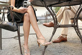 Two business's legs under a coffee table while in a meeting outdoors — Foto de Stock