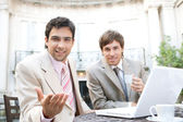 Two businessmen having a meeting in a classic coffee shop terrace — Stock Photo