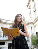 Attractive businesswoman standing in a luxury classic architecture coffee shop terrace — Stock Photo