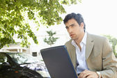 Portrait of an attractive businessman using a pc laptop computer — Stock Photo